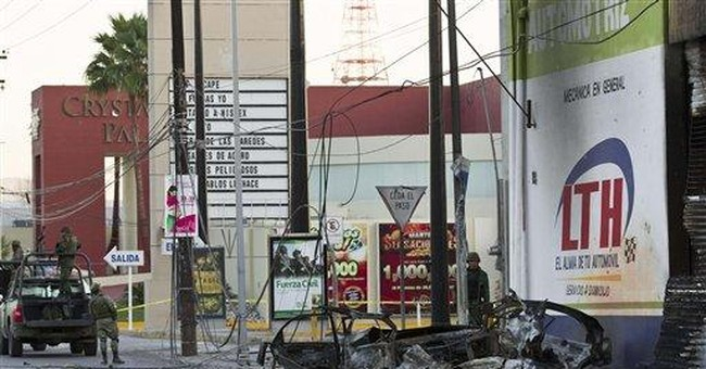 Car explodes in northern Mexico as soldiers pass
