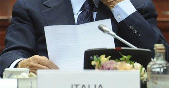 Pressed by EU, Berlusconi reaches pension deal