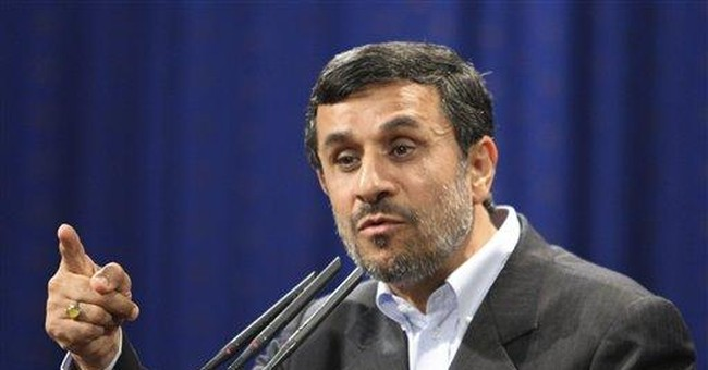 Ahmadinejad's foes flex power in Iran's parliament
