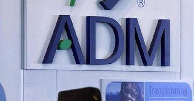 ADM earns up on accounting gain, adj profit falls