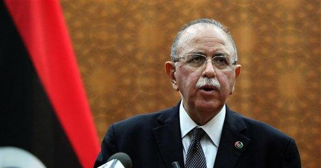 Libya's new PM balances demands of ex-rebels, West