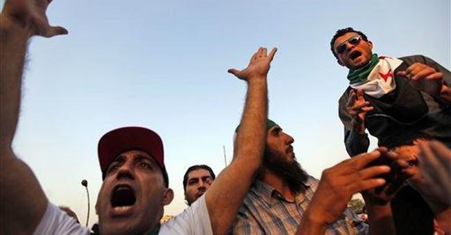 Syrian tanks fire on Homs, defy Arab-brokered deal