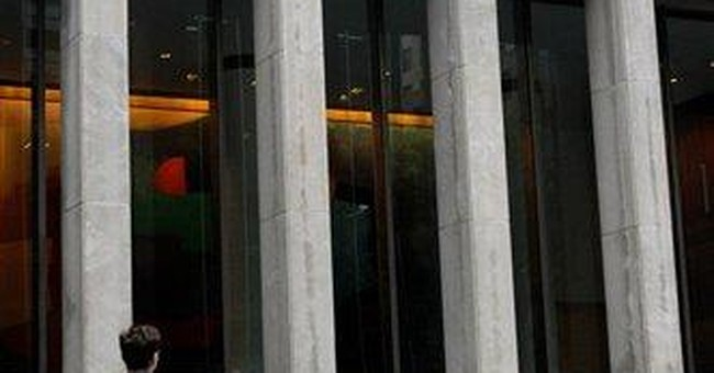 News Corp 1Q profit falls on charges from scandal