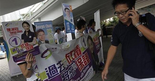HK pro-democracy parties lose ground in local vote