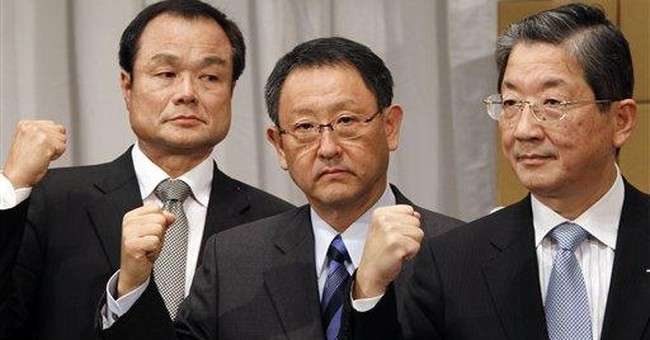 Japan executives, unions demand lower auto taxes