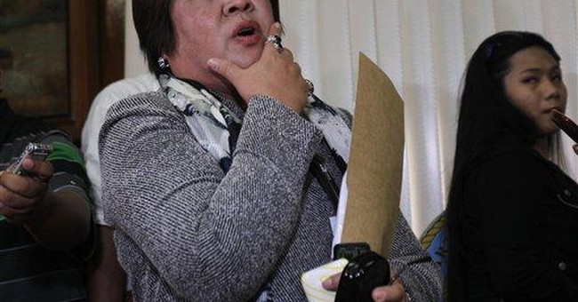 Philippines bars ill Arroyo from treatment abroad