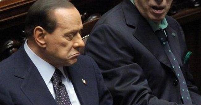 Defiant Berlusconi taken down by markets