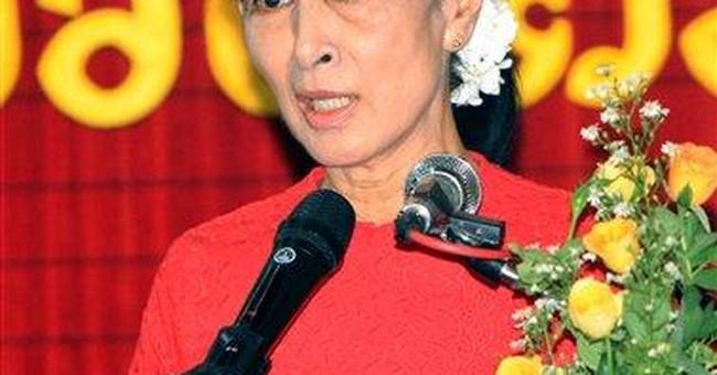 Myanmar's Suu Kyi to run in parliamentary polls