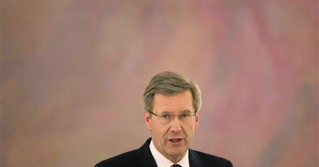 German president apologizes over loan controversy