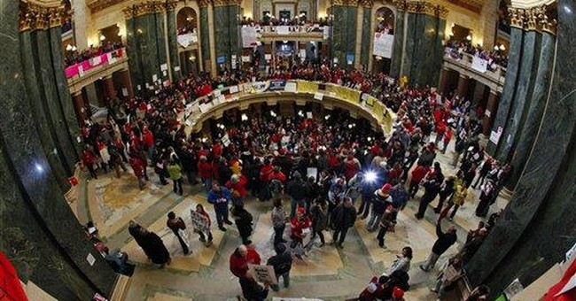 Wisconsin governor seizes chance to take on unions