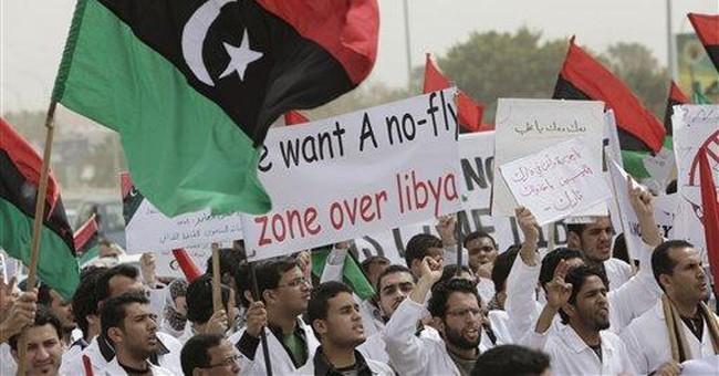 Air and ground: Gadhafi, rebels each claim control