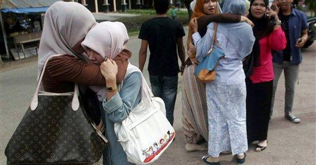 Panic but no tsunami from strong Indonesia quakes