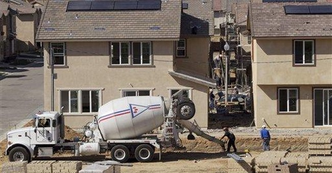 US home building slows, permits hit 3 1/2-year high