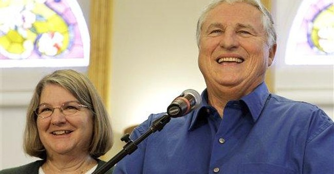 Retired Ill. couple claims share of $656M jackpot