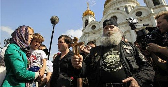 Russian activist detained for anti-Putin prayer