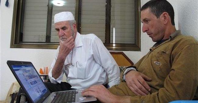 Palestine's exiles find family bonds thru Facebook