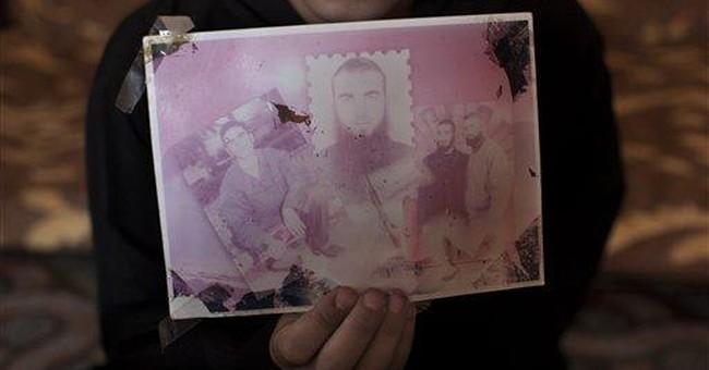 Palestinian prisoners portraits underscore absence