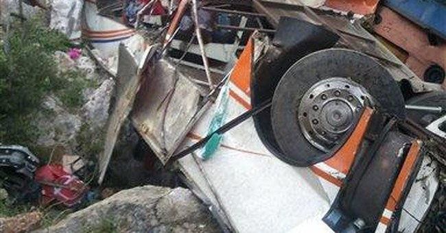 Bus with students falls off Albania cliff; 12 die