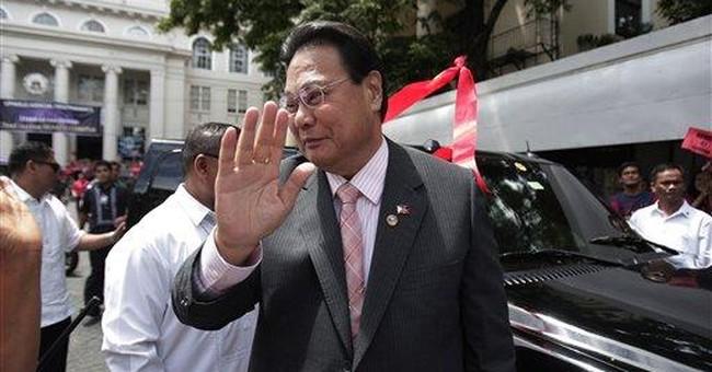 Philippine justice denies charges, blames Aquino