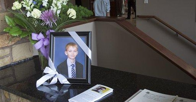 Russian boy killed in Nebraska fire laid to rest