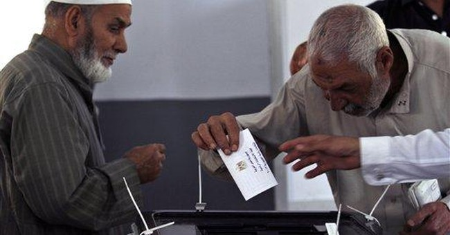 Eager Egyptians hold landmark presidential vote