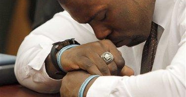 Exonerated ex-football star wants money from state