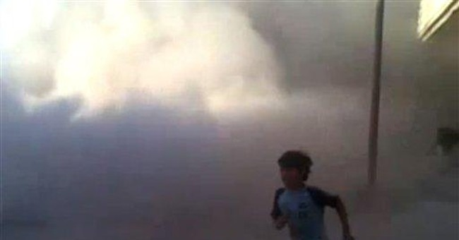 Australia expels 2 Syrian diplomats over massacre