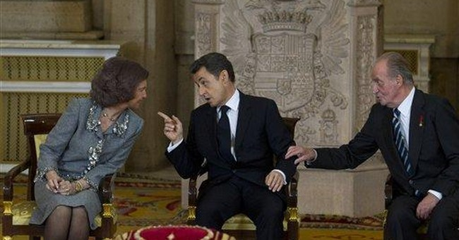 Feisty Sarkozy shrugs off French credit downgrade