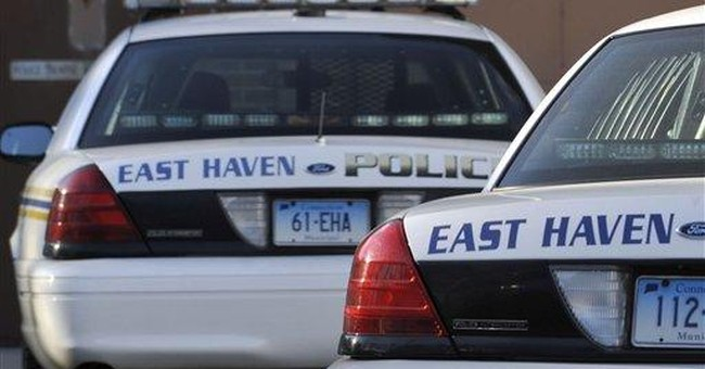 FBI arrests 4 police officers in Conn. bias probe