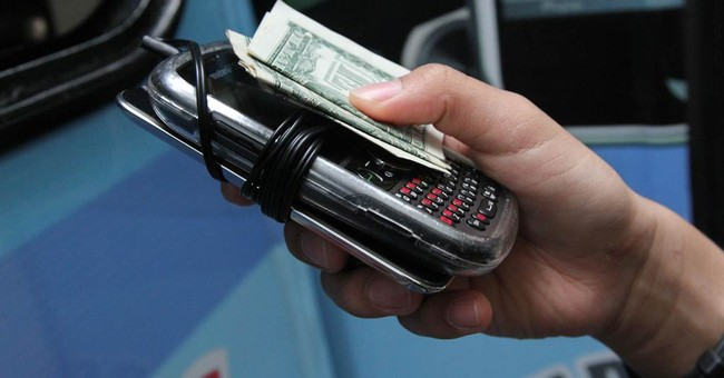 A phone home: NY teens pay valets to store devices
