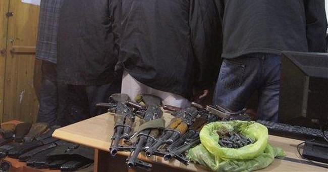 Afghanistan arrests British contractors with guns
