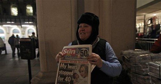 Murdoch's Sunday tabloid launches in defiant mood