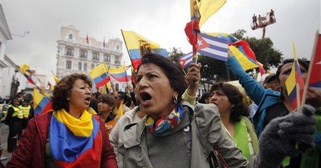 Correa pardons newspaper in libel case