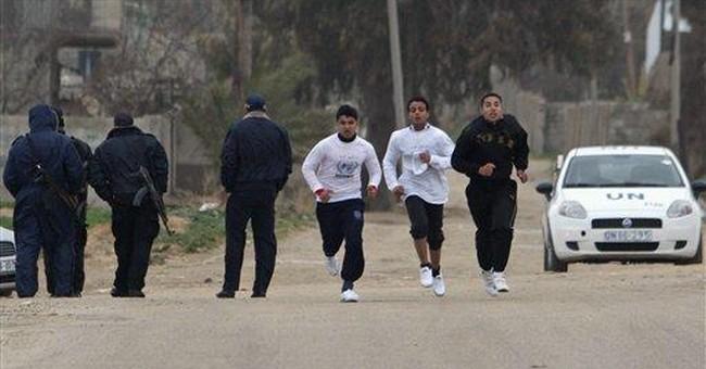 Gaza marathon draws hundreds in rainy weather