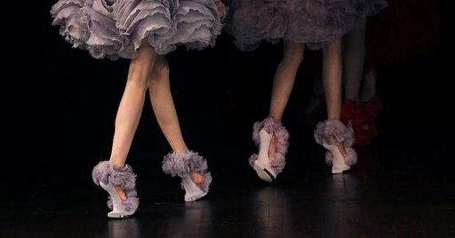 Burton creates a 3-D feather fantasy for McQueen