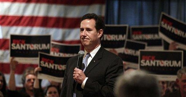 After Louisiana win, Santorum vows to fight on