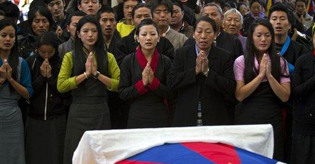 Thousands attend India funeral of Tibetan activist