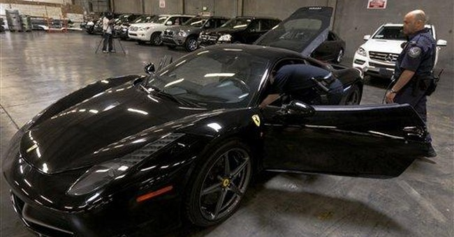 Feds in LA seize 16 upscale cars bound for Asia