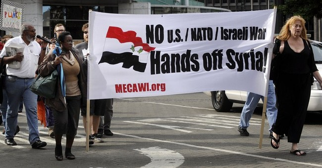 Specter of Iraq Hovers over Syria Deliberation