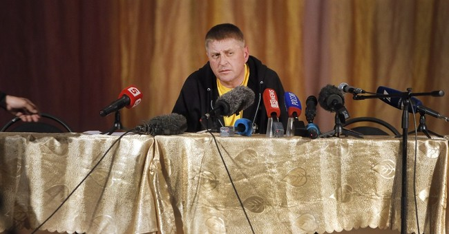 In Ukraine's east, mayor held hostage by insurgent