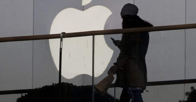 Apple increases stock buyback, will split stock