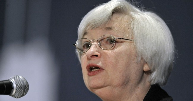 Fed cuts monthly bond purchases and sounds upbeat