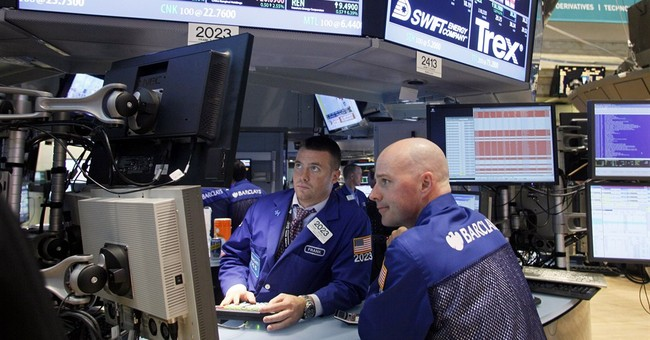 Stocks fall back from record levels