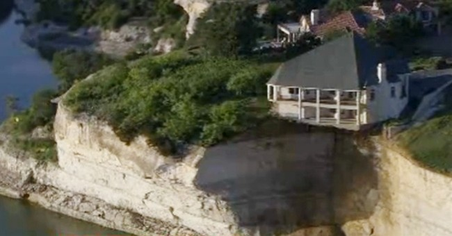 House teeters on edge of crumbling 75-foot cliff