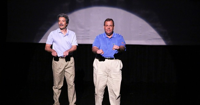 Christie tries to move past scandal with comedy