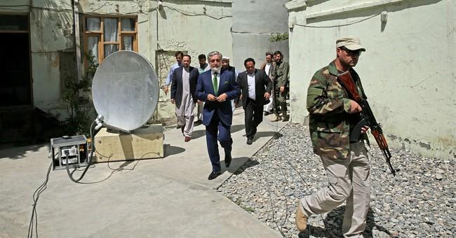 Afghan candidate seeks halt to runoff vote count