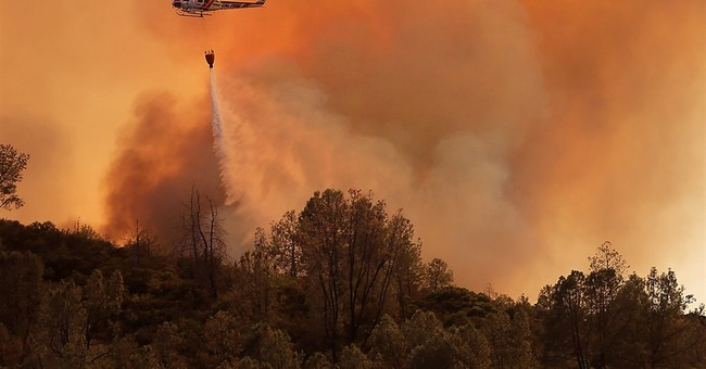 California wildfires grow in north, south