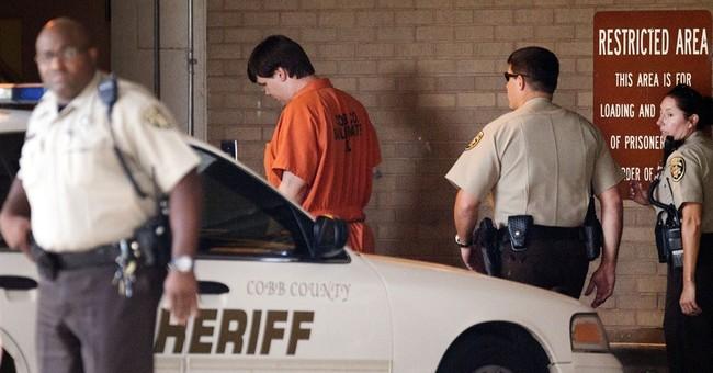 Police: Dad sent nude photos while boy sat in car