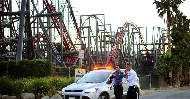 Tree toppled onto coaster; left riders dangling