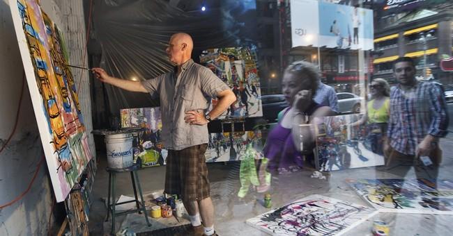Pedestrians watch artists work in NYC storefront